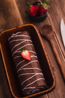 Delicious chocolate roll with cream