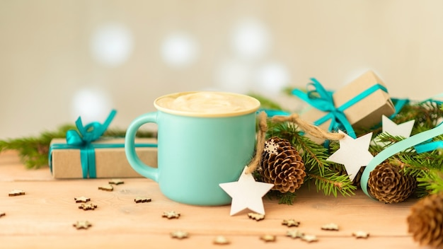 Delicious christmas coffee. and fir branches with cones.
