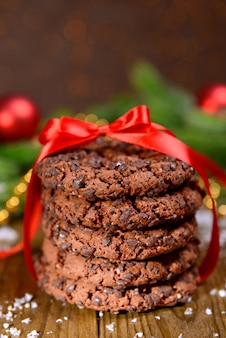 Delicious christmas cookies in jar on table on brown background