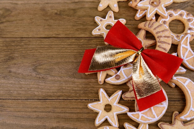 Delicious christmas cookies on wooden background
