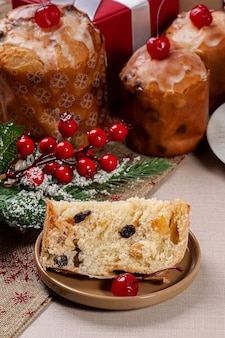 Delicious christmas homemade mini panettones with fruits and nuts with christmas elements