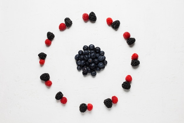 Delicious circle of wild berries and strawberries