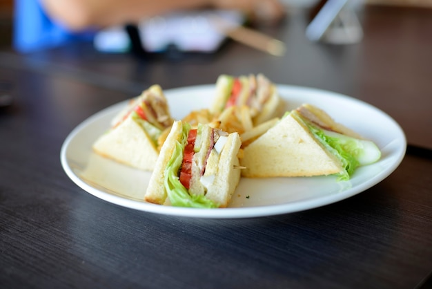 Delicious club sandwich and french fries