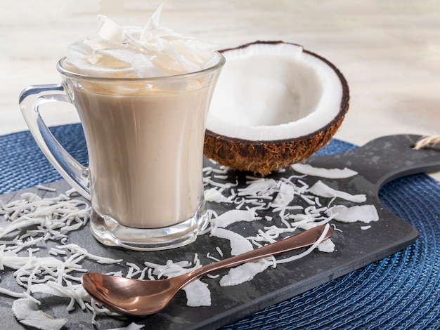 Delicious coconut mousse in glass cup.