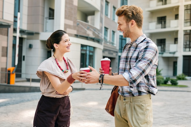 Delicious coffee. happy young woman taking a drink while looking at her boyfriend