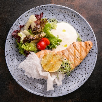 Delicious cooked fish meal on plate Premium Photo
