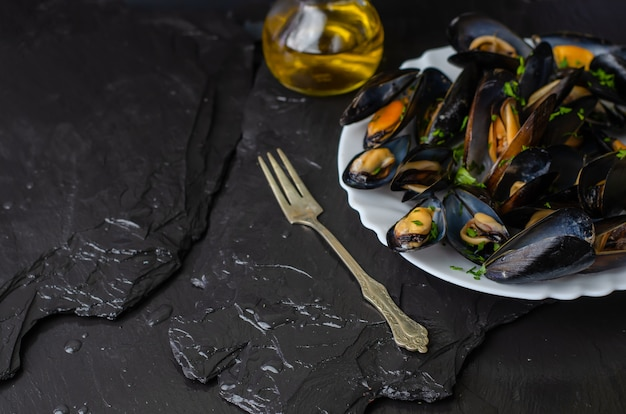 Delicious cooked seafood mussels with herbs and olive oil. mediterranean cuisine