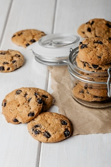 Delicious cookies jar on table