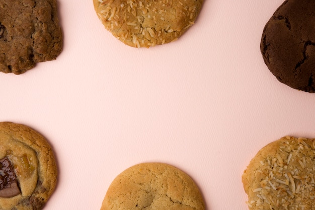 Delicious cookies on pink background