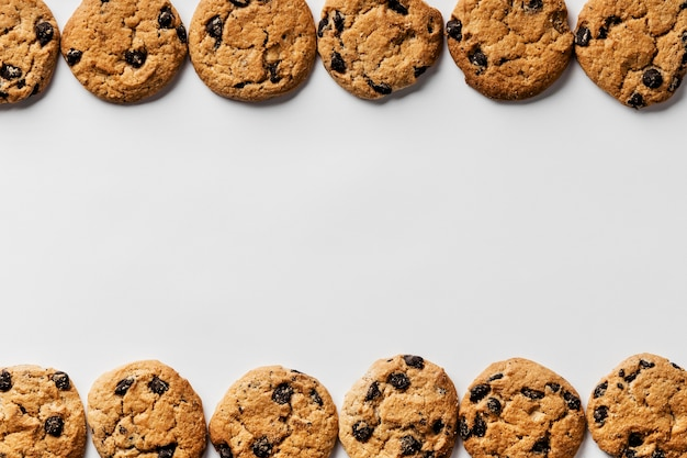 Delicious cookies in row with copy space