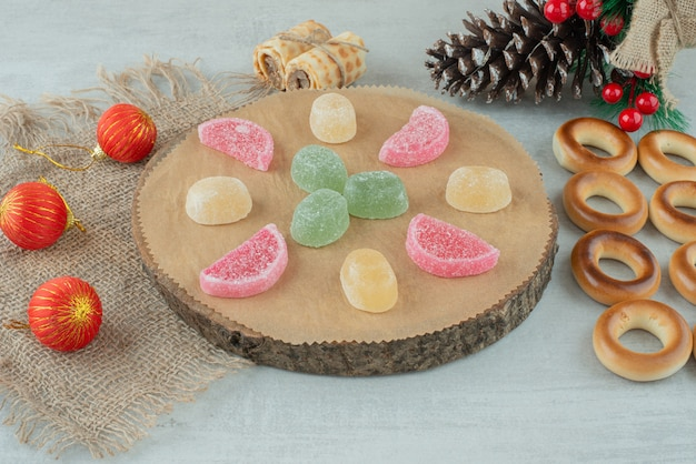 Delicious cookies with christmas balls on sackcloh . high quality photo