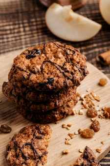 Delicious cookies on wooden board close up