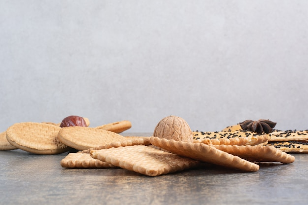 Delicious crackers with nut and star anise on marble background. high quality photo