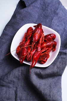 Delicious crayfishes on a white plate