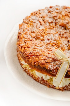 Delicious cream cake with almond. close up