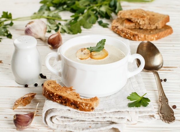Delicious cream soup with mushrooms