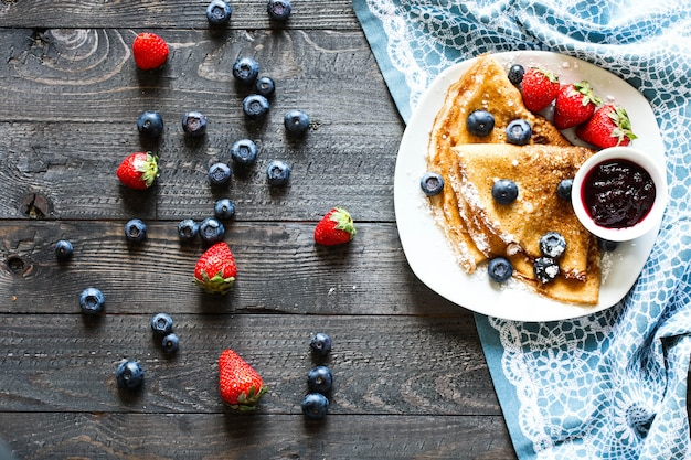 Delicious crepes with strawberries and blueberries
