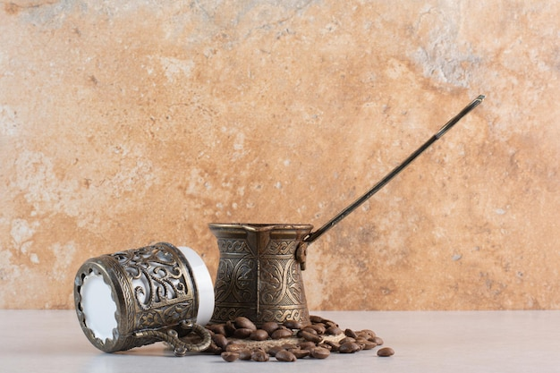 Delicious cup of aroma fresh cup of coffee beans . high quality photo