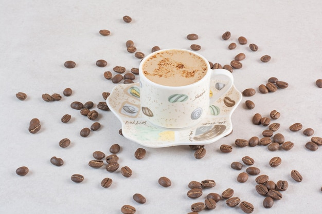 Delicious cup of aroma fresh cup of coffee with coffee beans . high quality photo