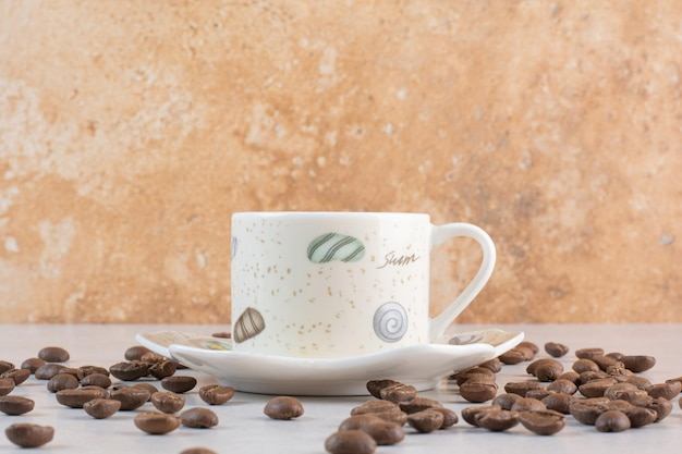 Delicious cup of aroma fresh cup of coffee with coffee beans