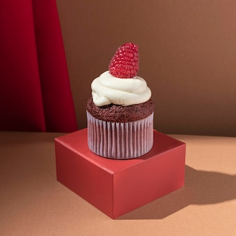 Delicious cupcake with raspberry