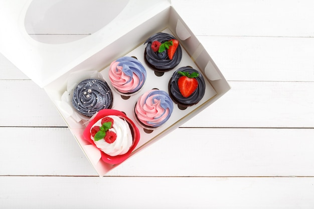 Delicious cupcakes on a colored. festive, birthday