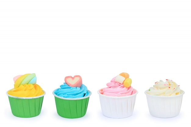 Delicious cupcakes isolated on white background.