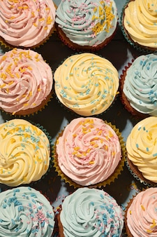 Delicious cupcakes with glaze top view