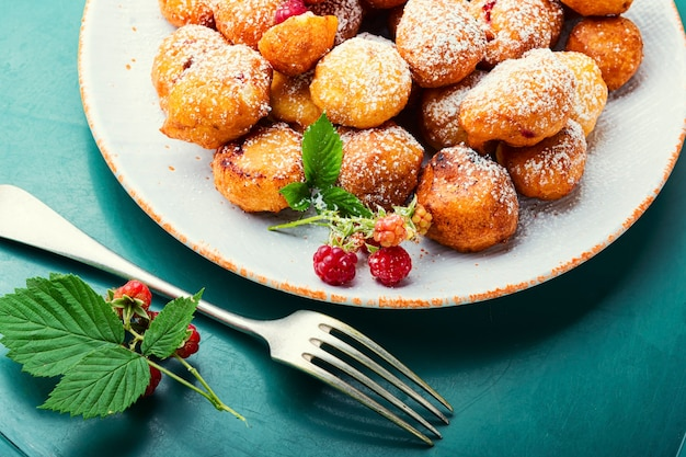 Delicious curd donuts with raspberries.donuts on a plate.delicacy.