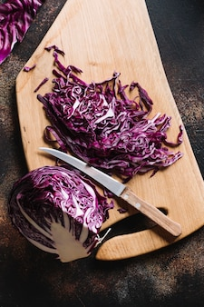 Delicious cut red cabbage with knife