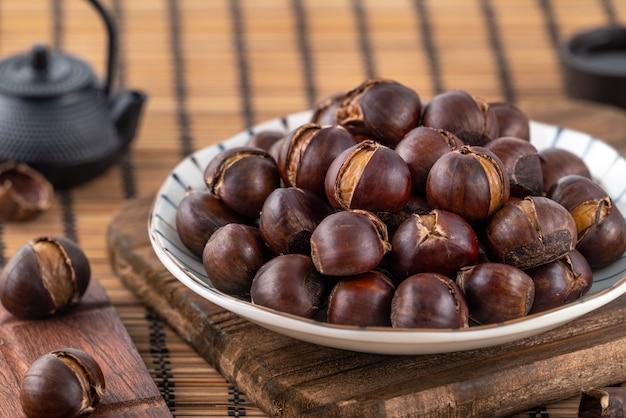 Delicious cut roasted chestnuts with oil and sugar, healthy eating snack in life, close up.