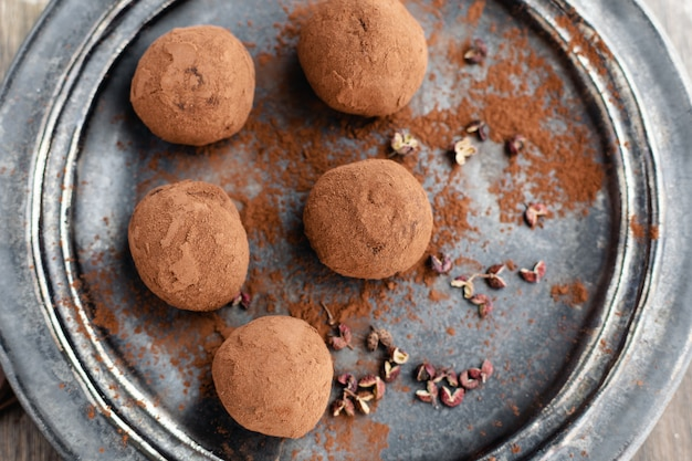 Delicious dark chocolate candy truffles with sichuan pepper, top view