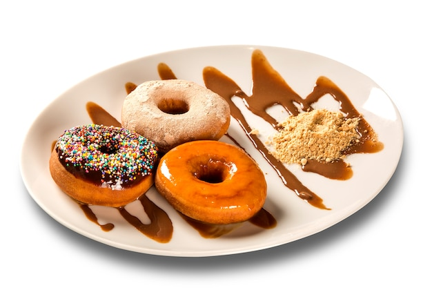 Delicious dessert donuts with ice cream on a white plate with decoration on a wooden table