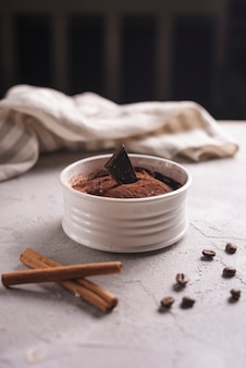 Delicious dessert with coffee beans and cinnamon