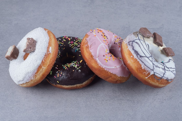 Delicious donuts bundled together on marble surface