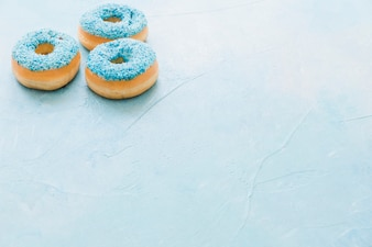 Delicious donuts on blue background