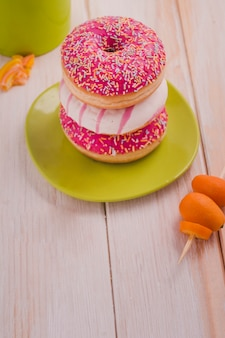 Delicious donuts with colourful sprinkles