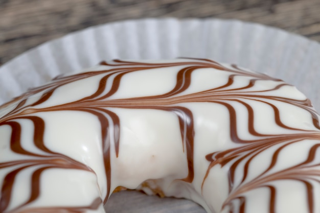 Delicious doughnuts with chocolate covered filling, close up