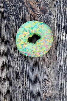 Delicious doughnuts with chocolate covered filling, delicious doughnuts made of dough and filling, fast food and desserts with a lot of calories
