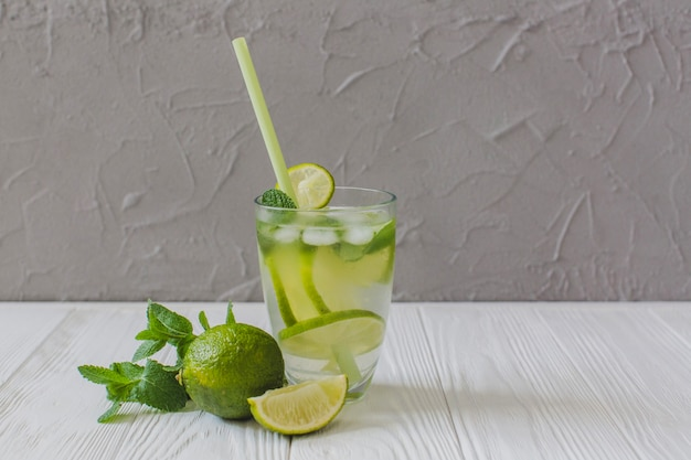 Delicious drink with lime slices