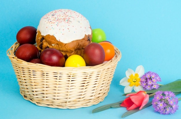 Delicious easter cake and colored eggs for easter celebration.