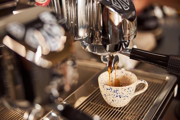 Delicious espresso made in the coffee house in modern machine