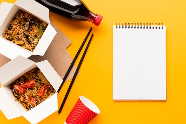 Delicious fast food boxes with clipboard