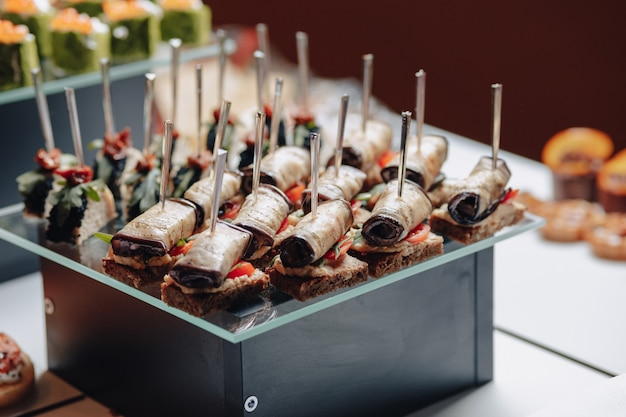 Delicious festive buffet with canapã©s and different delicious meals