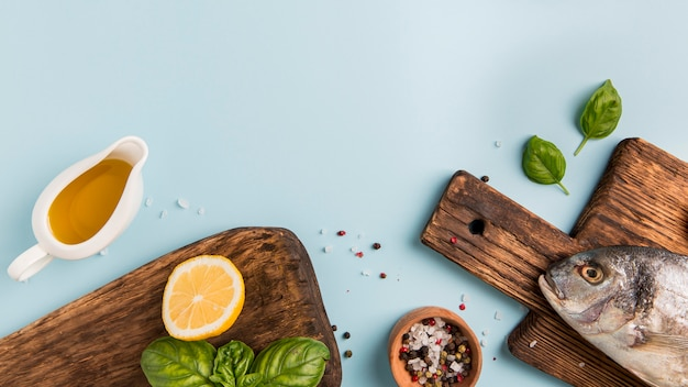 Delicious fish on wooden cutting board