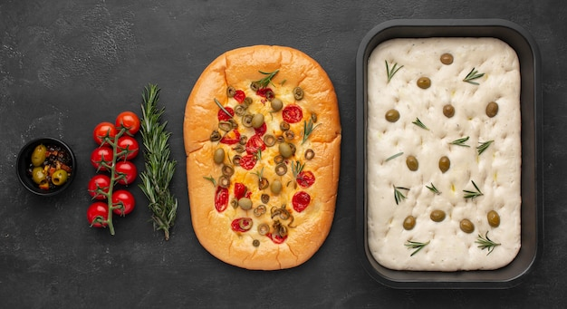 Delicious foccacia and ingredients flat lay