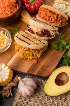 Delicious food on wooden board