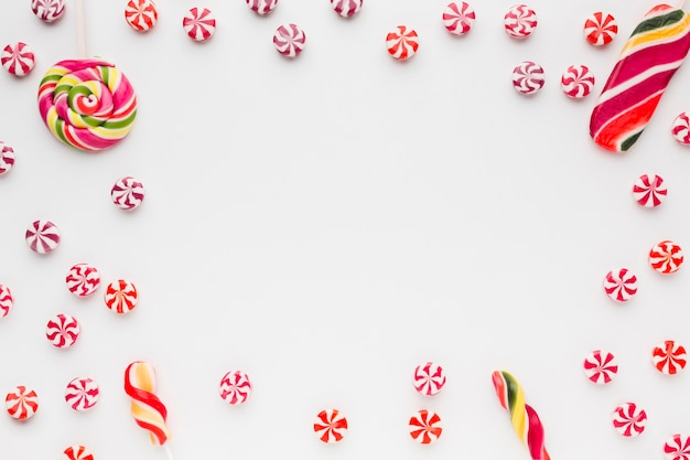 Delicious frame made of candies with copy space