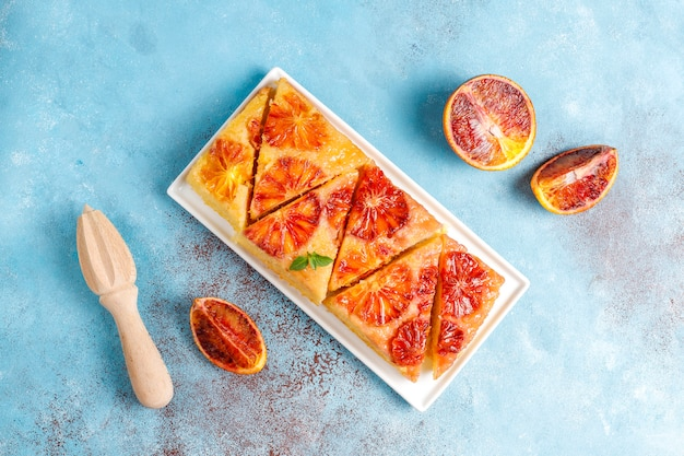 Delicious french dessert tart tatin with blood orange