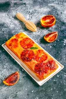 Delicious french dessert tart tatin with blood orange.